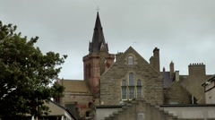 Scotland Orkney Islands Kirkwall 048 St. Magnus Cathedral tower behind a gable Stock Footage