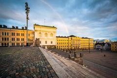 Rainbow over Senaatintori, Senate Square at sunset, in Helsinki, Finland. Stock Photos