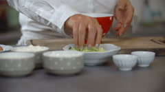 Stock Video Footage of Cook working with ingredient and cup in kitchen