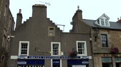 Scotland Orkney Islands Kirkwall 006 original British facades in main street Stock Footage