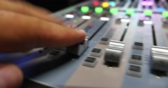 A fast audio adjustment on an audio mixer in a recording studio - stock footage