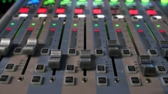 A colorful audio mixer, the knobs are being pulled automatically up and down Stock Footage