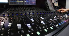 A man shutting down an audio mixer Stock Footage