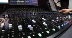 A man shutting down an audio mixer - stock footage