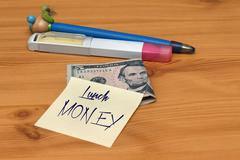 Lunch money note parents left to their kids to spend for food in school Stock Photos