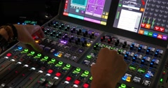 A man working in a studio on an audio mixer Stock Footage