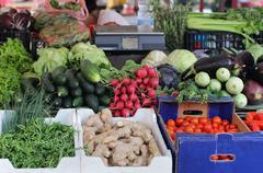 Fresh organic vegetables crates on market stall Stock Photos