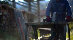 Two workers sawing wood on table saw Stock Footage