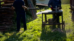 Sawing firewood with saw table outside Stock Footage