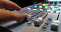 Stock Video Footage of A fast audio adjustment on an audio mixer in a recording studio