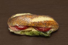 Healthy ham and tomato sandwich inside cellophane wrap Stock Photos