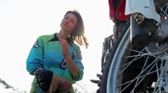 Young Female Biker Sending an Air Kiss Stock Footage