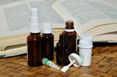 Homeopathic remedies and remedy guide book - stock photo