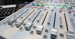 A moving shot of an audio mixer,the knobs being pulled up and down automatically Stock Footage