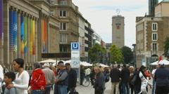 View of Mercedes star and people gathered next to Konigsbau Passagen, Stuttgart Stock Footage