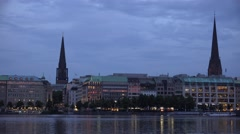 4K Beautiful Hamburg skyline twilight waterfront building lake church tower icon Stock Footage
