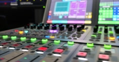 Footage of a colorful audio mixer, the shot is moving from left to right Stock Footage