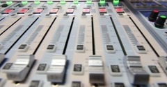 Close up shot of an audio mixer, the knobs are being pulled up and down Stock Footage