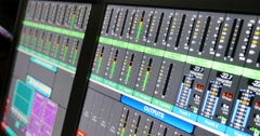 Footage of an audio mixers screen and the audio equalizers jumping Stock Footage