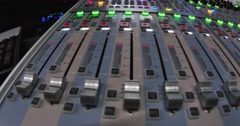 Footage of an audio mixer, the shot is moving from left to right Stock Footage
