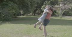 Two sisters hugging outdoors Stock Footage