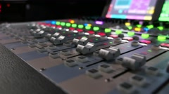 Footage of an audio mixer, the shot moves from the right to the left Stock Footage