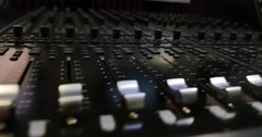 Footage of an audio mixer, the shot is moving from the left to the right Stock Footage