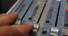 Close up shot of an audio mixer and a man pulling up the knobs Stock Footage