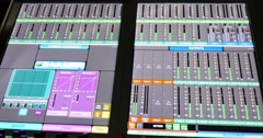 Footage of an audio mixer´s screen and the audio equalizers jumping... - stock footage