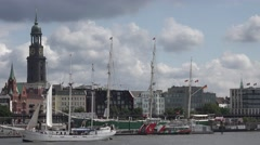 4K Touristic boat sail Hamburg old port church tower tourism attraction dockland Stock Footage
