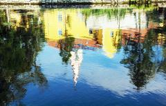 Church and convent in Tapolca is mirroring in the water level of the lake - stock photo