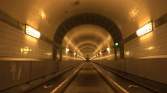 Stock Video Footage of POV Point of view walking alight tunnel commuter cross corridor Hamburg walkway