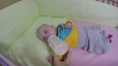 Closeup of baby drink milk powder mixture from bottle. 4K Stock Footage