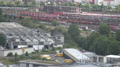 4K Aerial view Germany railway train Koln crowded depot stationary red wagon car Stock Footage