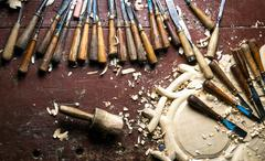 Wood carving tools on worktable Stock Photos