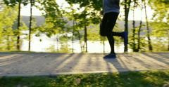 Young man running in park at morning during sun rise – slow motion - stock footage