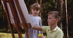 Artist school little girl painting brush watercolors portrait Stock Footage