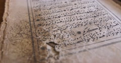 Footage of an old Qur´an, the shot moves from the bottom to the top Stock Footage