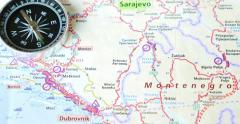 A road map showing Kosovo, Montenegro, Croatia and Bosnia, with a compass on it Stock Footage
