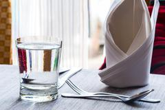 Water glass on dinning table Stock Photos