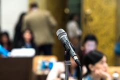 Close up of microphone in concert hall or conference room Stock Photos