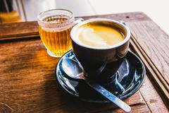 Working time. hot coffee and hot tea on wood table. Stock Photos