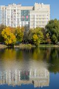 Soviet Style Building and Water Reflection - stock photo
