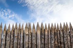 Wooden palisades Stock Photos