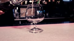 Pour alcohol into a glass  - stock footage