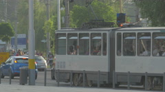 WOld tram and cars on a street in Cluj-Napoca Stock Footage