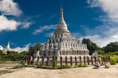 White Pagoda at Inwa city with lions guardian statues. Myanmar (Burma) - stock photo