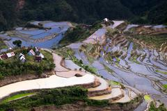 Village houses near rice terraces fields. Amazing abstract texture with sky c - stock photo