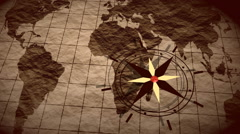 Compass above moving grunge world map Stock Footage