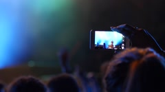 Spectators shooting video of a music concert performance via smart phone camera Stock Footage
